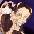 血の滴る子どもの生首を握りながら満面の笑み 葛飾北斎「百物語 笑い般若」
